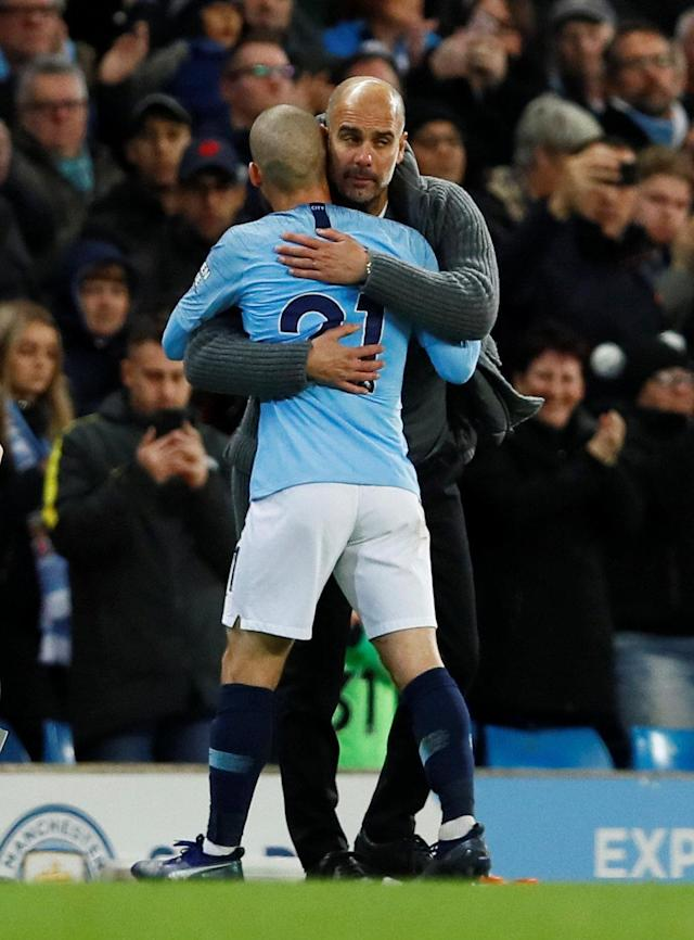 """Soccer Football - Premier League - Manchester City v Manchester United - Etihad Stadium, Manchester, Britain - November 11, 2018 Manchester City's David Silva with manager Pep Guardiola as he is substituted off Action Images via Reuters/Jason Cairnduff EDITORIAL USE ONLY. No use with unauthorized audio, video, data, fixture lists, club/league logos or """"live"""" services. Online in-match use limited to 75 images, no video emulation. No use in betting, games or single club/league/player publications. Please contact your account representative for further details."""