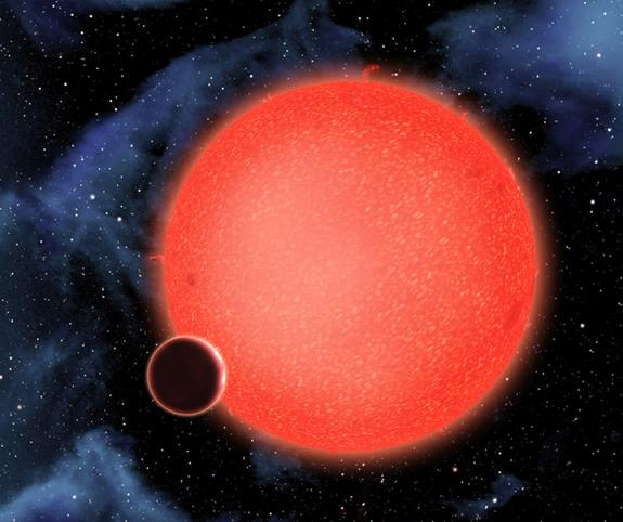 Artist's conception of GJ1214b, a super-Earth that could have a surface dominated by ocean, orbiting its red dwarf star. Observations with the Hubble Space Telescope revealed a thick atmosphere.