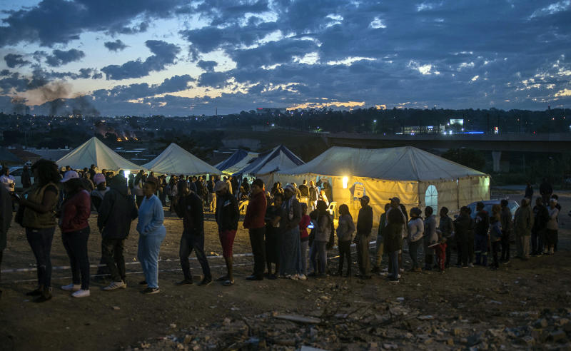 Residents of Alexandra Township queue to cast their votes in Johannesburg, Wednesday, May 8, 2019. South Africans are voting Wednesday in a national election that pits President Cyril Ramaphosa's ruling African National Congress against top opposition parties Democratic Alliance and Economic Freedom Fighters, 25 years after the end of apartheid. (AP Photo/Mujahid Safodien)