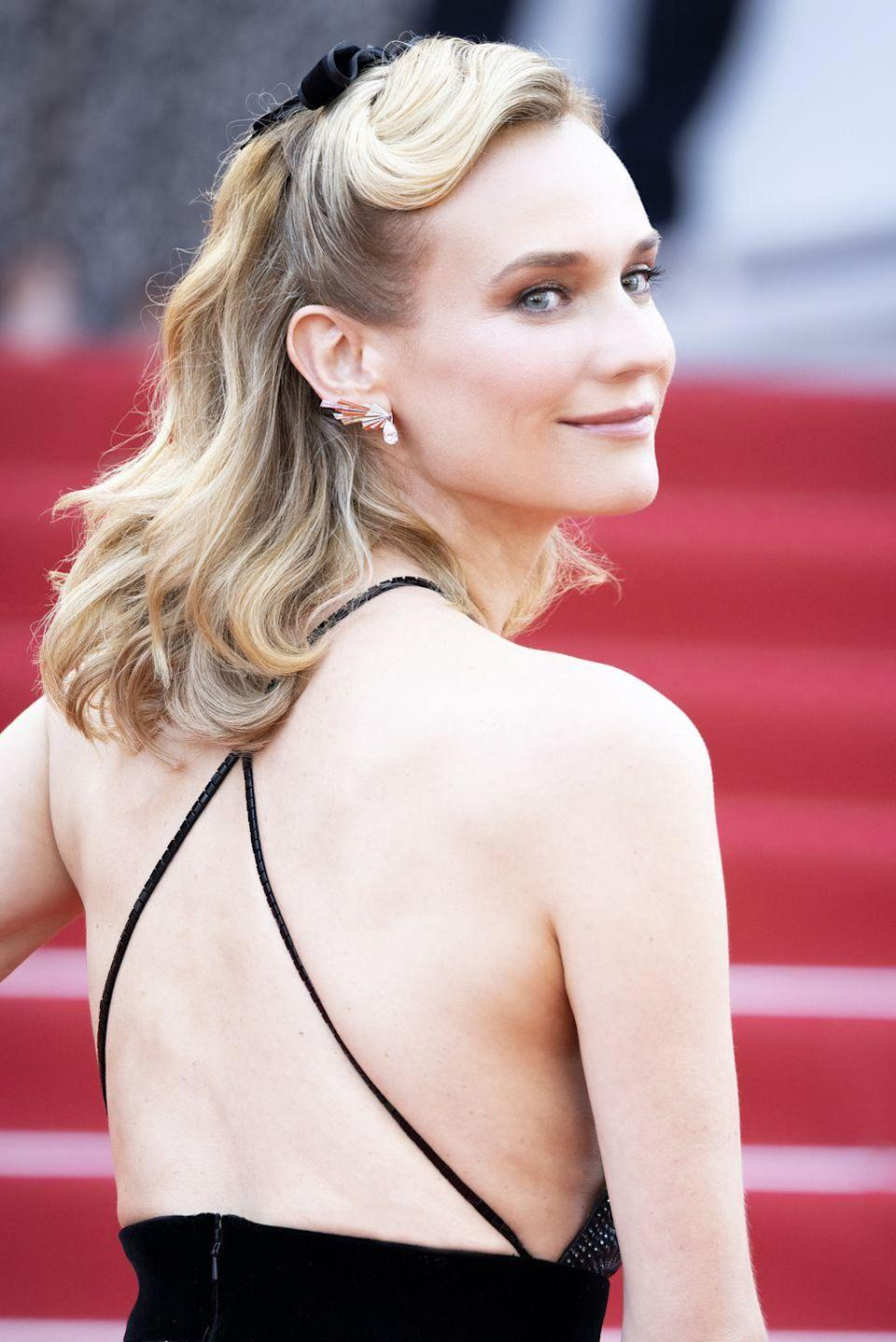 <p>Kruger offset her crystal-embellished Giorgio Armani gown with a pair of high jewellery earrings by Chaumet. </p>