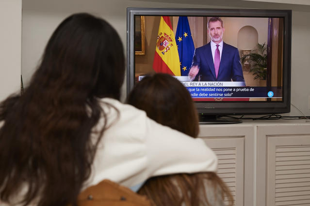 MADRID, SPAIN - MARCH 18: Two woman watching the King Felipe VI of Spain speech at home on March 18, 2020 in Madrid, Spain. King Felipe VI of Spain speaks to the Nation due to Covid-19 crisis. (Photo by Carlos Alvarez/Getty Images)