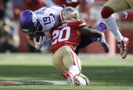Minnesota Vikings wide receiver Adam Thielen (19) is tackled by San Francisco 49ers free safety Jimmie Ward (20) during the first half of an NFL divisional playoff football game, Saturday, Jan. 11, 2020, in Santa Clara, Calif. (AP Photo/Ben Margot)