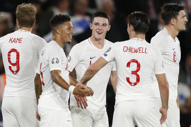 Jadon Sancho celebrates with teammates after scoring his first England goal. (ADRIAN DENNIS/AFP/Getty Images)