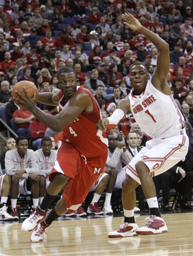 Miami (Ohio)'s Julian Mavunga, left, drives to the basket against Ohio State's Deshaun Thomas during the first half of an NCAA college basketball game Thursday, Dec. 22, 2011, in Columbus, Ohio. (AP Photo/Jay LaPrete)