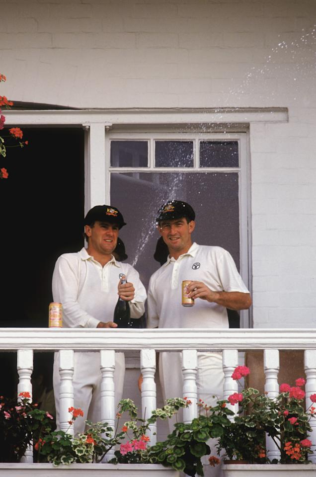 Australian cricketers Mark Taylor and Geoff Marsh celebrate their stand of 329 for the first wicket during the 5th Test in the Ashes series at Trent Bridge, 10th - 15th August 1989. (Photo by Adrian Murrell/Getty Images)
