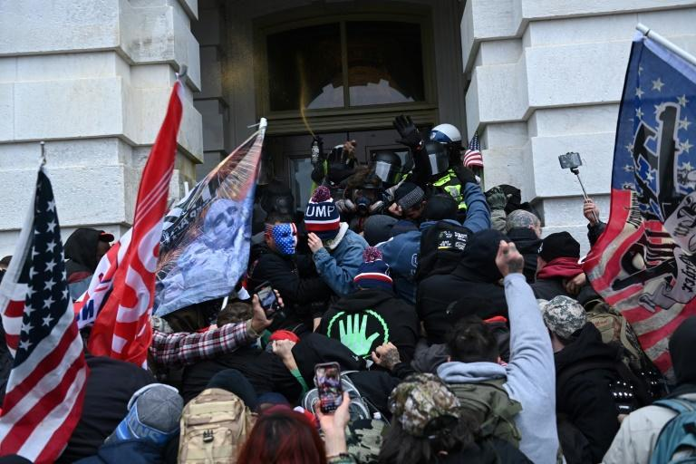 Trump supporters clash with police and security forces as they storm the US Capitol hoping to reverse his loss in the presidential election