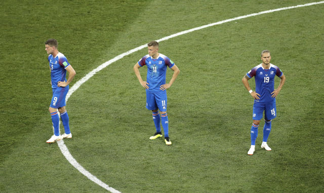 Iceland players react in dejection at the end of the group D match between Nigeria and Iceland at the 2018 soccer World Cup in the Volgograd Arena in Volgograd, Russia, Friday, June 22, 2018. (AP Photo/Themba Hadebe)