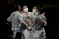 South Korea team celebrate defeating Italy and won the gold medal in the men's individual Sabre team final medal competition at the 2020 Summer Olympics, Tuesday, July 27, 2021, in Chiba, Japan. (AP Photo/Hassan Ammar)