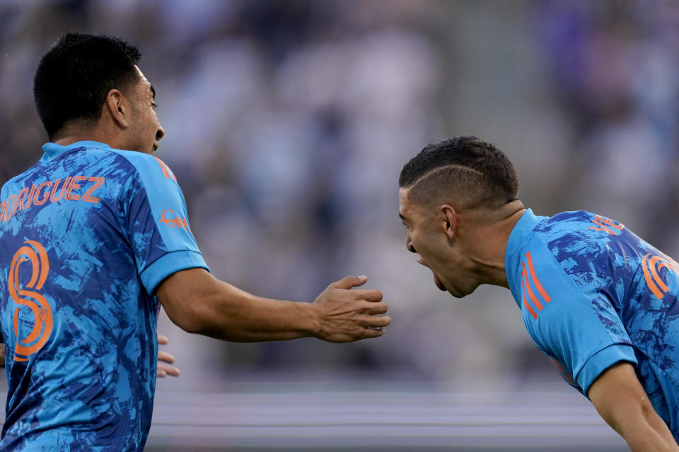 Houston Dynamo midfielder Matias Vera, right, celebrates with Homidfielder Memo Rodriguez (8) after scoring a goal during the first half of an MLS soccer match against Sporting Kansas City Saturday, May 29, 2021, in Kansas City, Kan. (AP Photo/Charlie Riedel)