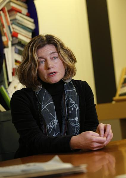 "In this photo taken Tuesday, Nov. 12, 2013, chief editor of Le Monde newspaper Natalie Nougayrede, speaks during an interview with The Associated Press, in Paris, Tuesday. As revelations about the staggering scope of the NSA's surveillance have cascaded around the world, newsroom leaders weighed ethical decisions over how much they should reveal about intelligence. Nougayrede said the paper has not come under pressure from French authorities to turn over documents or withhold information but is keeping the documents it obtained ""in a safe place"" that she would not describe. (AP Photo/Christophe Ena)"