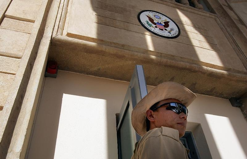 (FILES) -- File picture dated June 29, 2004 shows a private security guard standing at the front entrance of the new US embassy building in in Baghdad's Green Zone (AFP Photo/SCOTT NELSON)