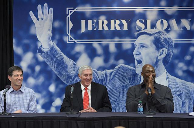 John Stockton, left, and Karl Malone, right, laugh during a news conference to honor former Utah Jazz coach Jerry Sloan, center, on Friday, Jan. 31, 2014, in Salt Lake City. (AP Photo/The Salt Lake Tribune, Scott Sommerdorf)