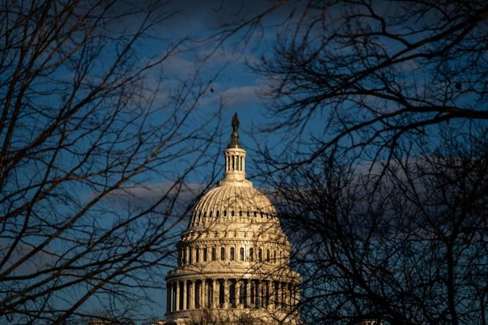 WASHINGTON, DC - JANUARY 18: The dome of the U.S. Capitol Building is bathed in afternoon light on Monday, Jan. 18, 2021 in Washington, DC. After last week's riots and security breach at the U.S. Capitol Building, the FBI has warned of additional threats in the nation's capital and across all 50 states. (Kent Nishimura / Los Angeles Times)