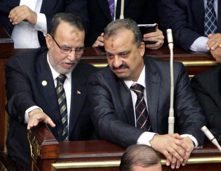 FILE - In this Monday, Jan. 23, 2012 file photo, Essam el-Erian, left, vice chairman of the Freedom And Justice party, and on his right, Muslim Brotherhood member Mohamed El-Beltagy attend the first Egyptian parliament session after the revolution that ousted former President Hosni Mubarak, in Cairo, Egypt. Egyptian state television and police officials say they have arrested two top Muslim Brotherhood figures, including including an outspoken former lawmaker El-Beltagy who has made public appeals for protests against the new military-backed government. Officials say El-Beltagy and former Labor Minister Khaled Al-Azhari were arrested Thursday in an apartment not far from the Pyramids of Giza. (AP Photo/Asmaa Waguih, Pool, File)