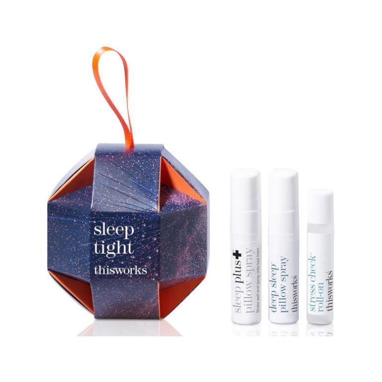 """<p><a rel=""""nofollow noopener"""" href=""""https://www.lookfantastic.com/this-works-sleep-tight-3-x-5ml/11498858.html"""" target=""""_blank"""" data-ylk=""""slk:Look Fantastic"""" class=""""link rapid-noclick-resp"""">Look Fantastic</a> - £13 </p><p>A good night's sleep is something <em>no-one</em> will want to re-gift. This Works' nifty bauble boasts two dreamy-scented pillow sprays for an interrupted snooze and the ELLE-approved Stress Check Roll On, which is packed with lavender and frankincense to promote calm and tranquillity when dotted on to pulse points. And breathe...</p>"""