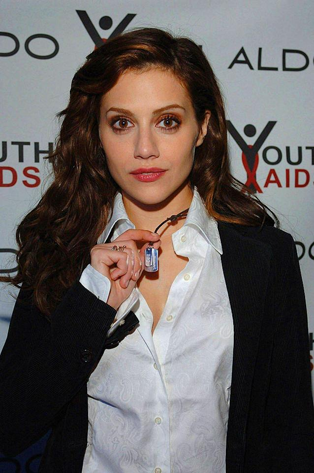 "Brittany Murphy shows off her ""Empowerment Tags,"" which feature the motto ""Hear No Evil, See No Evil, and Speak No Evil."" Sales of the dog tags benefit YouthAids, an HIV/AIDS education and prevention initiative. Peter Lindbergh/<a href=""http://www.splashnewsonline.com"" target=""new"">Splash News</a> - March 6, 2006"