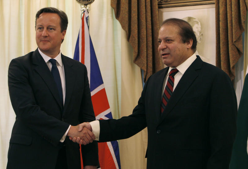 British Prime Minister David Cameron, left, shakes hand with his Pakistani counterpart Nawaz Sharif prior to their meeting in Islamabad, Pakistan, Sunday, June 30, 2013. Cameron is in Islamabad on a tow-day visit to hold talks with Pakistani top leaders on bilateral interest, regional and international importance including the peace process in Afghanistan. (AP Photo/Anjum Naveed)