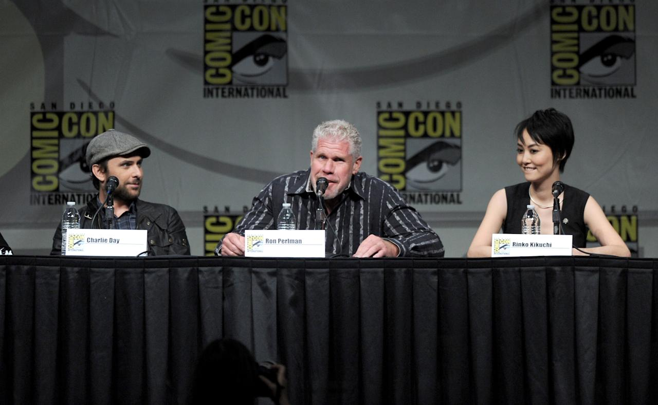 """SAN DIEGO, CA - JULY 14:  (L-R) Actors Charlie Day, Ron Perlman, and Rinko Kikuchi speak at Warner Bros. Pictures and Legendary Pictures Preview of """"Pacific Rim"""" during Comic-Con International 2012 at San Diego Convention Center on July 14, 2012 in San Diego, California.  (Photo by Kevin Winter/Getty Images)"""