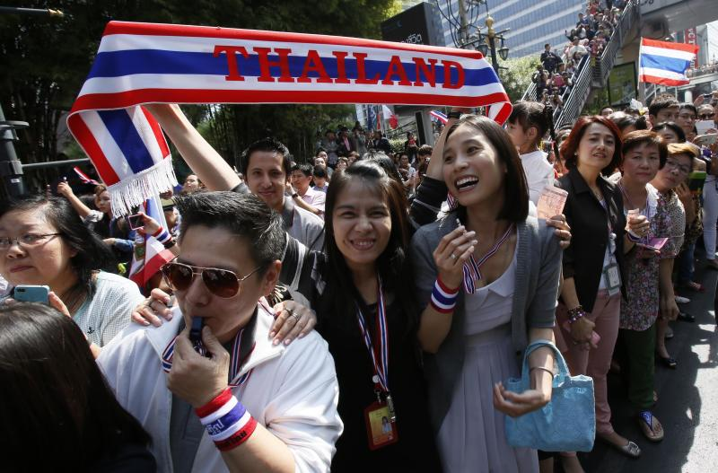 Supporters of the anti-government movement show their excitement for the approaching demonstration in Bangkok, Thailand, Tuesday, Jan. 21, 2014. Thailand has declared a state of emergency in Bangkok and its surrounding areas to cope with anti-government protests that have stirred up violent attacks. (AP Photo/Wally Santana)