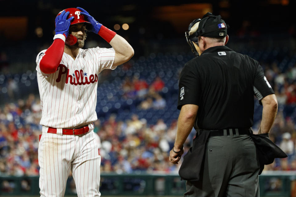 Philadelphia Phillies' Bryce Harper, left, reacts to umpire Lance Barksdale after striking out against Atlanta Braves relief pitcher Jerry Blevins during the seventh inning of a baseball game, Tuesday, Sept. 10, 2019, in Philadelphia. Philadelphia won 6-5. (AP Photo/Matt Slocum)