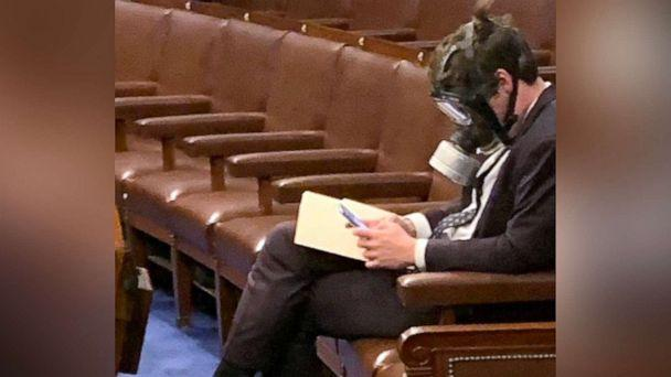 PHOTO: Rep. Matt Gaetz wears a gas mask on the House floor in Washington during a vote on coronavirus emergency funding, in a photo posted to Twitter by Rep. Jim Hines on March 4, 2020. (Jim Himes via Twitter)