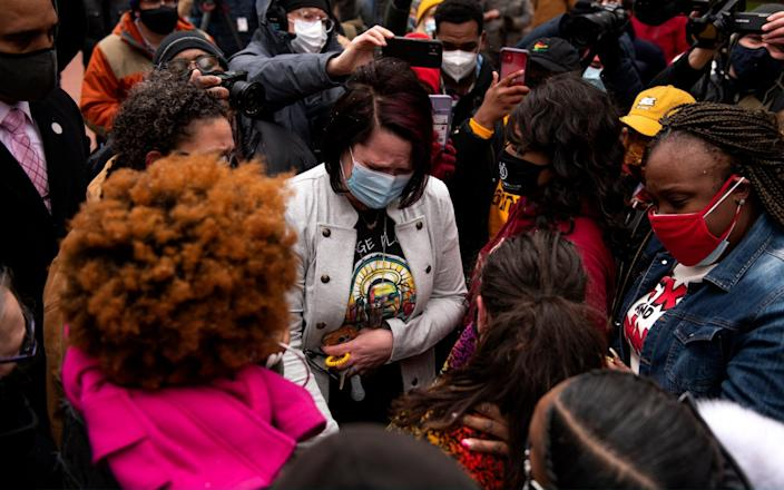 Courteney Ross (C), George Floyd's girlfriend, meets Katie Wright, the mother of Daunte Wright, who was killed by police in Minnesota last week - Stephen Maturen/Getty Images
