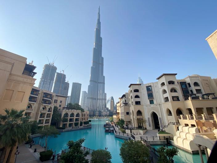 FILE PHOTO: A general view shows the area outside the Burj Khalifa, the world's tallest building, mostly deserted, after a curfew was imposed to prevent the spread of the coronavirus disease (COVID-19), in Dubai, United Arab Emirates March 25, 2020. REUTERS/Tarek Fahmy