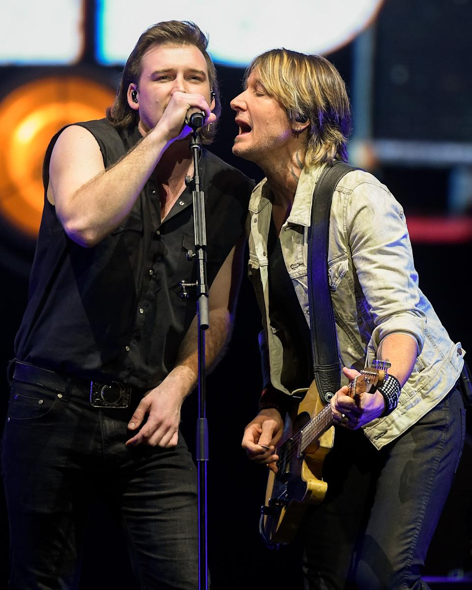Morgan Wallen performs with Keith Urban during the All the Hall benefit concert at Bridgestone Arena in Nashville, Tenn., Monday, Feb. 10, 2020.
