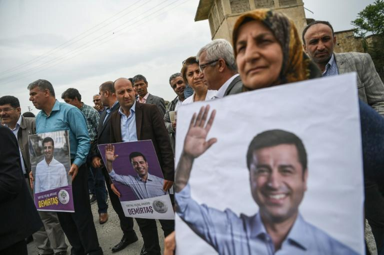 The incarcerated Demirtas remains a champion of Turkey's Kurdish minority, like these supporters near the priso in Edrine where he is being held