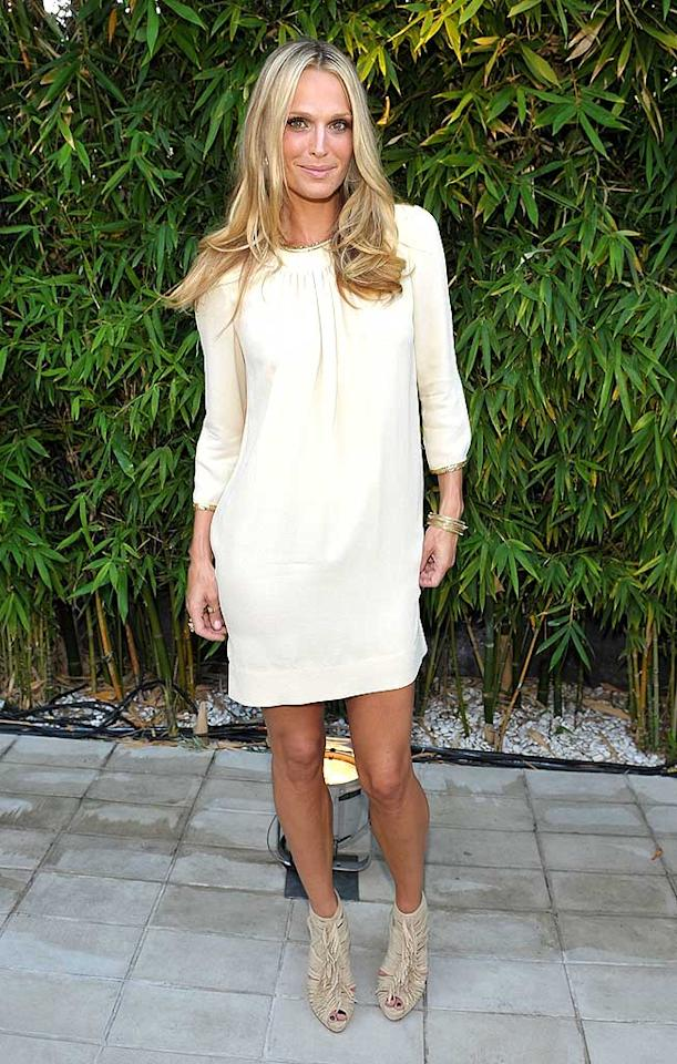 "Model/actress Molly Sims oozed sophistication at Vogue's 1-year anniversary party for 3.1 Phillip Lim's LA store in an off-white dress, with a gold embellished neckline, and $950 fringed Christian Louboutin booties. John Shearer/<a href=""http://www.gettyimages.com/"" target=""new"">GettyImages.com</a> - July 15, 2009"