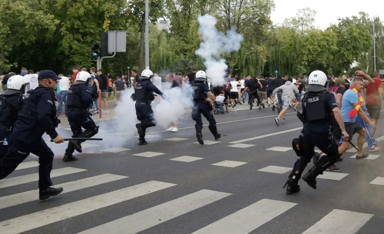 Riot police fire tear gas to disperse people after ultra-nationalists attacked the Gay Pride march