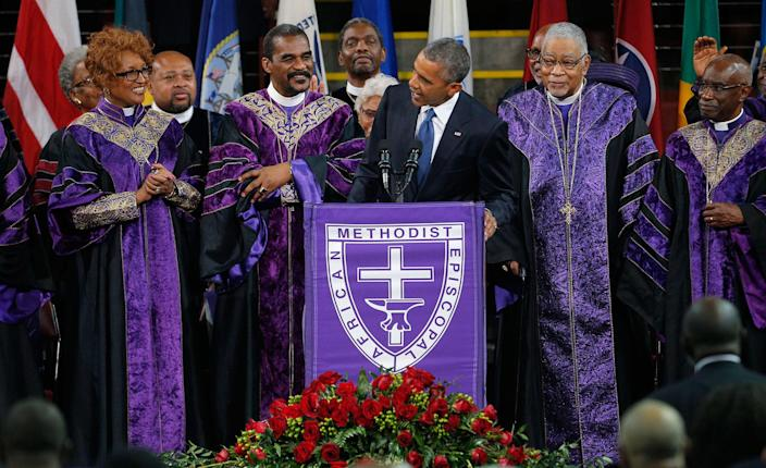 """President Obama leads mourners in singing """"Amazing Grace"""" as he delivers a eulogy for the Rev. Clementa Pinckney during funeral services in Charleston, S.C., June 26, 2015. Pinckney was one of nine victims of a mass shooting at the Emanuel African Methodist Episcopal Church. (Brian Snyder/Reuters)"""