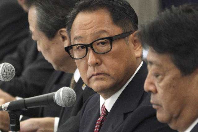 CORRECTS COMPANY NAME TO TOYOTA MOTOR CORP. - Akio Toyoda, center, president and CEO of Toyota Motor Corp., with a group of the Japanese automakers chiefs speaks to Japanese Trade Minister Isshu Sugawara, not in picture, during a meeting Thursday, Sept. 26, 2019, in Tokyo. The U.S. and Japan on Wednesday signed a limited trade deal that will eliminate tariffs and expand market access on farm, industrial and digital products. But the deal does not address autos, a key sticking point during months of contentious negotiations, and President Donald Trump indicated the two countries were still working on a broader agreement. (AP Photo/Eugene Hoshiko)
