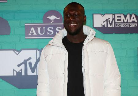 FILE PHOTO: British Hip Hop artist Stormzy arrives at the 2017 MTV Europe Music Awards at Wembley Arena in London.