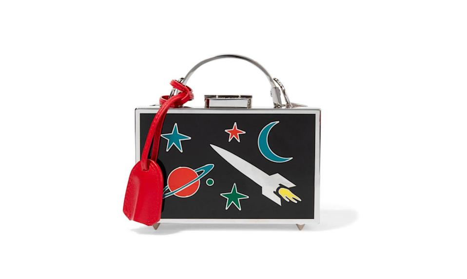 "<p>Out of this world and boxed to perfection from Mark Cross.</p><p>Mark Cross Grace Mini Metal and Enamel Shoulder Bag, $4500, <a href=""https://www.net-a-porter.com/us/en/product/710331/Mark_Cross/grace-mini-metal-and-enamel-shoulder-bag"" rel=""nofollow noopener"" target=""_blank"" data-ylk=""slk:Net-A-Porter.com"" class=""link rapid-noclick-resp"">Net-A-Porter.com</a></p>"