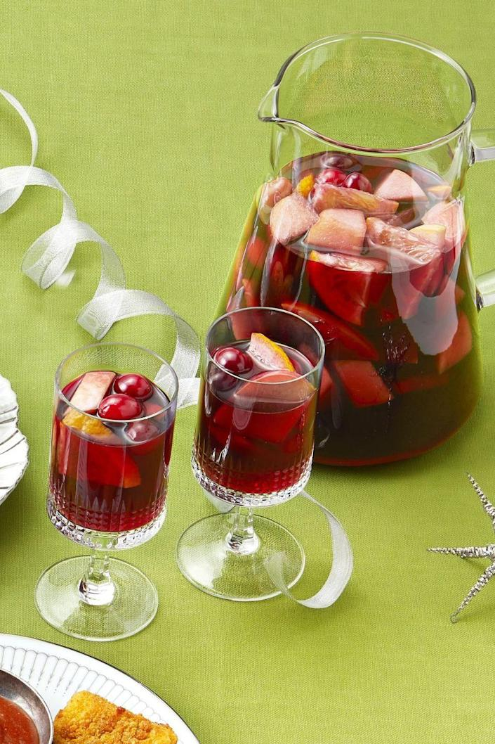 """<p>You can throw this wintery sangria together in minutes, then let it sit for a couple hours to bring out all the flavors.</p><p><strong><a href=""""https://www.thepioneerwoman.com/food-cooking/recipes/a32303964/winter-sangria-recipe/"""" rel=""""nofollow noopener"""" target=""""_blank"""" data-ylk=""""slk:Get Ree's recipe."""" class=""""link rapid-noclick-resp"""">Get Ree's recipe.</a></strong> </p>"""