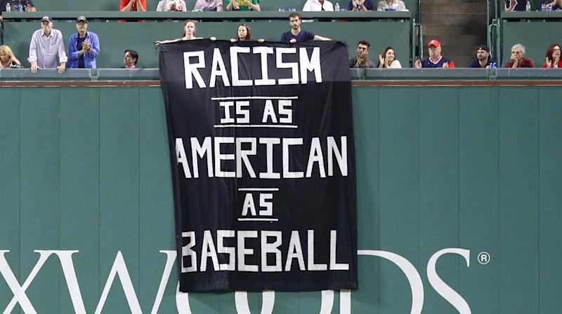 Protesters Unfurl 'Racism Is As American As Baseball' Sign At Boston Red Sox Game