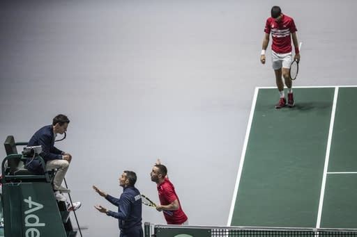 Serbia's captain Nenad Zimonjic and teammate Viktor Troicki, center, argue with the referee during the Davis Cup quarterfinal doubles match against Russia's Karen Khachanov and Andrey Rublev in Madrid, Spain, Friday, Nov. 22, 2019. (AP Photo/Bernat Armangue)