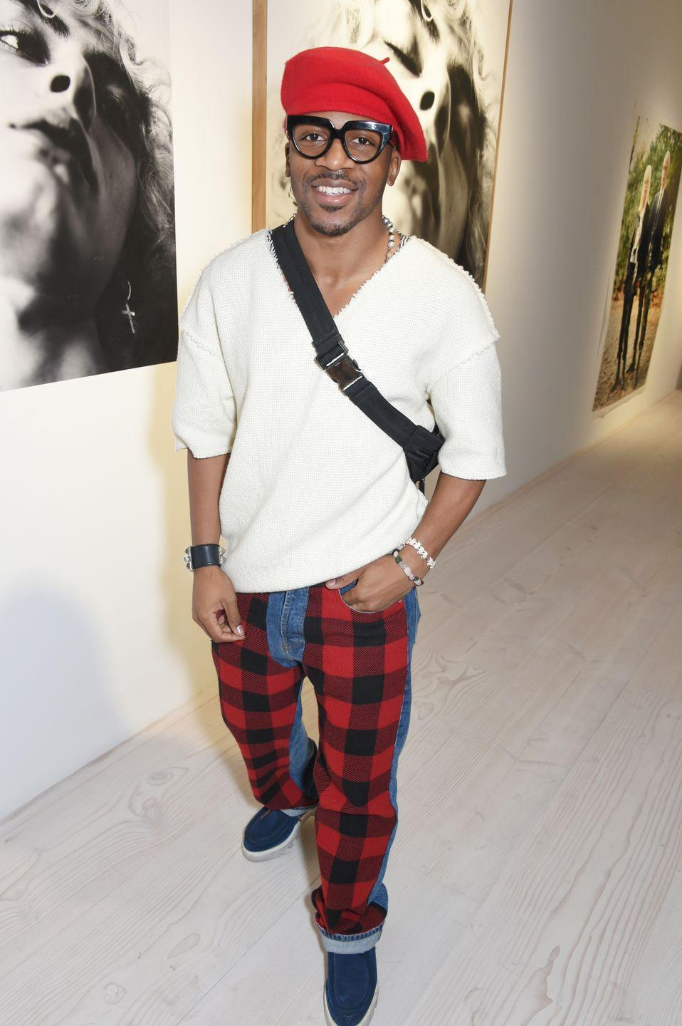 <p><strong>Brand</strong>: Romeo Hunte</p><p>Michelle Obama, Zendaya, Beyoncé, Saweetie, and Keke Palmer have all worn Hunte's designs. His outerwear definitely makes a statement, and he's known for using the buffalo-check pattern in many of his clothes, like on his jeans here. </p>