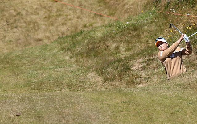 South Korea's Inbee Park plays her shot on the 9th fairway during the Final day of the Women's British Open golf championship at the Royal Birkdale Golf Club, in Southport, England, Sunday, July 13, 2014. (AP Photo/Scott Heppell)