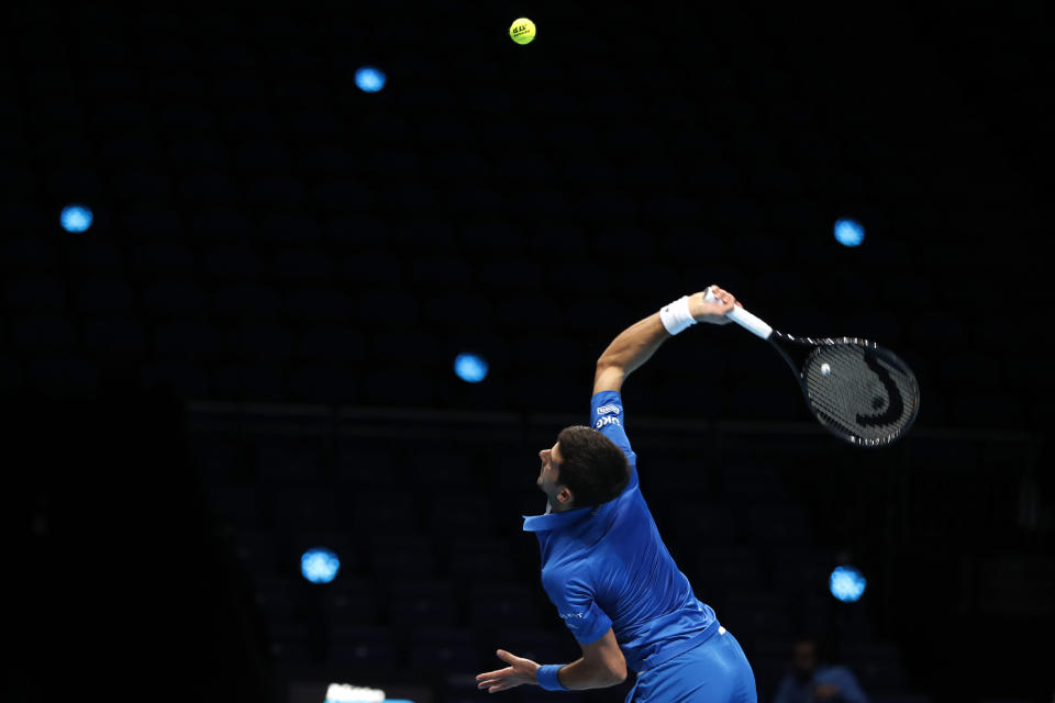 Novak Djokovic, of Serbia, plays a return to Alexander Zverev, of Germany, during their singles tennis match at the ATP World Finals tennis tournament at the O2 arena in London, Friday, Nov. 20, 2020. (AP Photo/Frank Augstein)