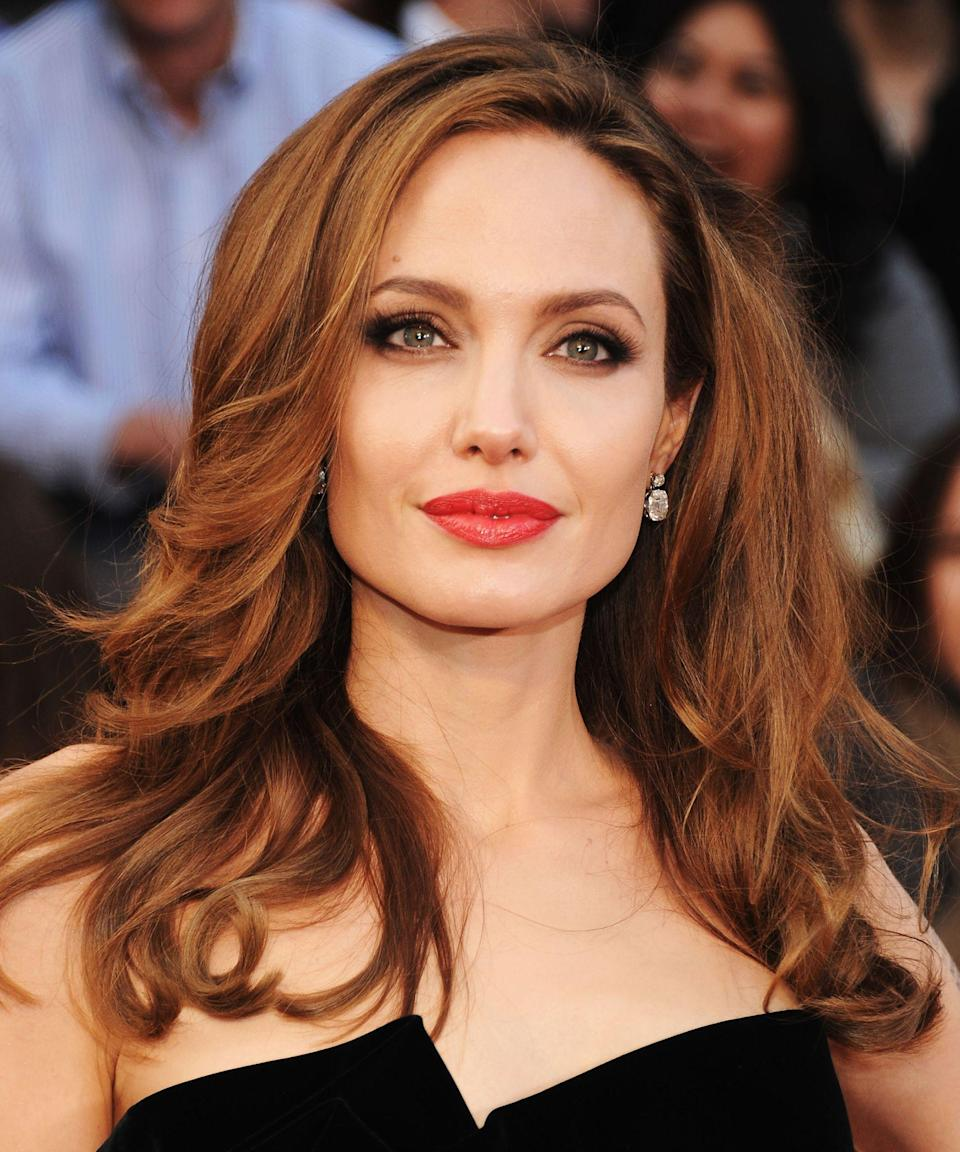 """<p><strong>Angelina Jolie, 2012</strong></p><p>This was the year Angelina Jolie's leg got all the attention — and its own <a href=""""https://twitter.com/angelinajoliesl?lang=en"""" rel=""""nofollow noopener"""" target=""""_blank"""" data-ylk=""""slk:Twitter"""" class=""""link rapid-noclick-resp"""">Twitter</a> account. But we were (and remain) firmly focused on the full-bombshell hair.</p><span class=""""copyright"""">Photo: Kevin Mazur/Getty Images.</span>"""