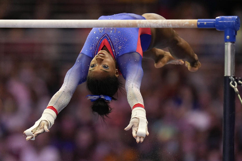 Simone Biles competes on the uneven bars during the women's U.S. Olympic Gymnastics Trials Friday, June 25, 2021, in St. Louis. (AP Photo/Jeff Roberson)