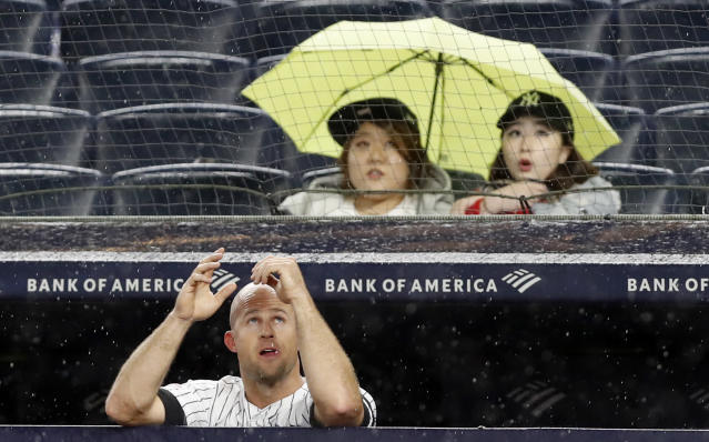 New York Yankees' Brett Gardner looks up at the sky as rain falls during the sixth inning of the team's baseball game against the Seattle Mariners, Tuesday, May 7, 2019, in New York. (AP Photo/Kathy Willens)