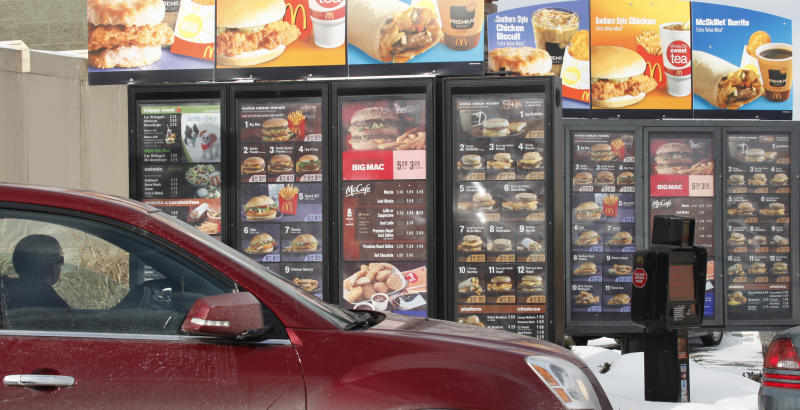 A protector looks at the menu at McDonald's in Williamsville, NY, Monday, January 26, 2009. As most restaurant businesses prepare for a bad earnings season in the fourth quarter, Nation's 1st hamburger chain reported strong sales of the same stores in the fourth quarter, which boosted the company's profits after Wall Street estimates. (AP Photo / David Duprey)