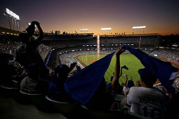 """Fans wave towels during Game 2 of the 2017 World Series between the Dodgers and Houston Astros at Dodger Stadium. <span class=""""copyright"""">(Sean M. Haffey / Getty Images)</span>"""
