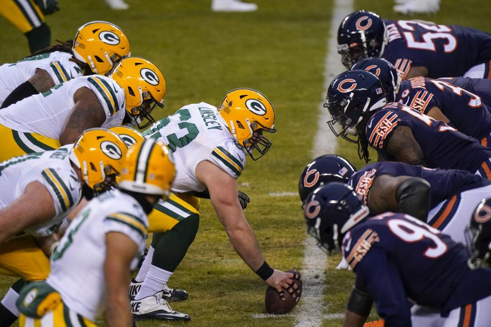FILE - Green Bay Packers' Corey Linsley snaps the ball during the first half of an NFL football game against the Chicago Bears in Chicago, in this Sunday, Jan. 3, 2021, file photo. Green Bay's offensive line lost two of its original five starters to season-ending knee injuries, with right guard Lane Taylor going down in the opener. They were missing All-Pro center Corey Linsley for three games at midseason. Now they're continuing their Super Bowl chase without David Bakhtiari. Yet the line hasn't missed a beat while helping make the Packers the NFL's highest-scoring team. (AP Photo/Nam Y. Huh, File)