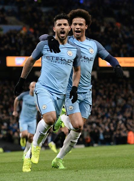 Manchester City's Sergio Aguero (L) celebrates scoring his team's second goal against Huddersfield at the Etihad Stadium in Manchester, north west England, on March 1, 2017
