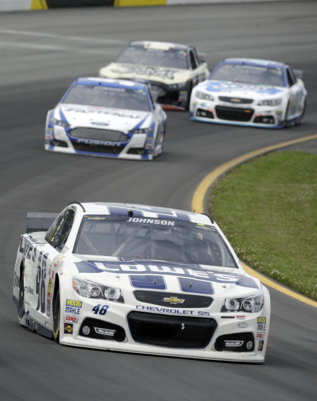 Jimmie Johnson (48) leads a group of racers through turn three during the NASCAR Sprint Cup series auto race at Pocono Raceway, Sunday, Aug. 3, 2014, Long Pond, Pa. (AP Photo/Mel Evans)