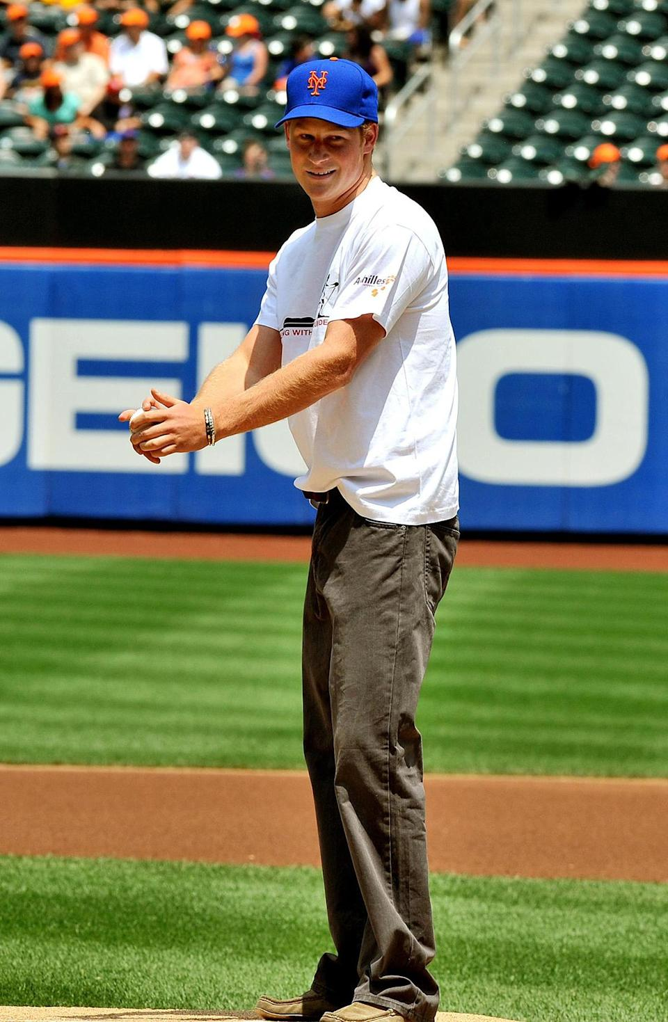 <p>Take Prince Harry out to the ball game! The royal tried his hand at baseball while throwing out the first pitch for the New York Mets in June 2010. </p>